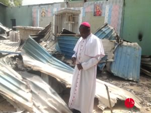 0511Nigeria_Bishop Oliver Dashe Doeme in the remains of a Catholic church in Bahuli
