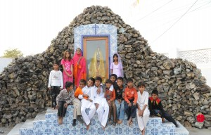 Children in front of a Marian Grotto, Diocese of Mulan.