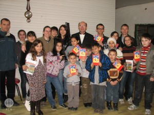 Children holding the ACN's Bible for children. We are there to help this tiny but active community.