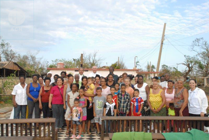 CUBA - Archdiocese of Camagüey - 17.09.2017<br /> After the Hurricane Irma: After the Holy Mass on the ruins of the chapel of Jiquí: Community members with Archbishop S.E.R. Mons. Wilfredo Pino Estevez and the Apostolic Nuntio S.E.R. Mons. Giorgio Lingua<br /> CUBA / CAMAGUEY 17/00223 PrID: 1705483<br /> Emergency aid for the purchase of 6,500 tales of zinc as emergency aid after the hurricane Irma<br /> Photo sent by S.E.R. Mons. Wilfredo Pino Estevez<br /> Foto con la comunidad de Jiquí después de la misa celebrada sobre las ruinas de la capilla que colapsó<br /> +Willy<br /> Only this very small file quality available