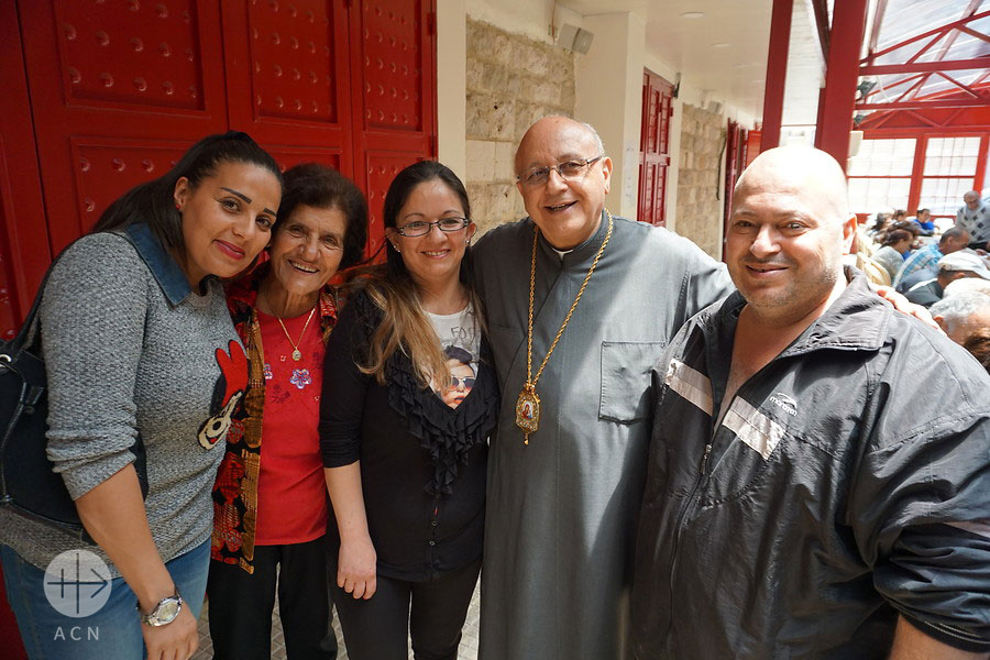 Families with Archbishop John Darwish at St John the Merciful Table, Zahle, Lebanon, providing meals to displaced families