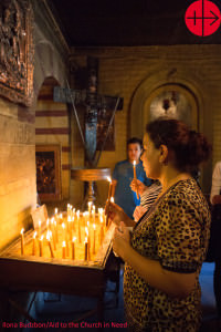 Egypt, October/November 2012 A young Coptic woman lights a candl