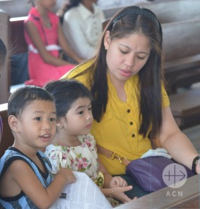 Children with their mother after the Sunday Mass in the Zamboanga Cathedral