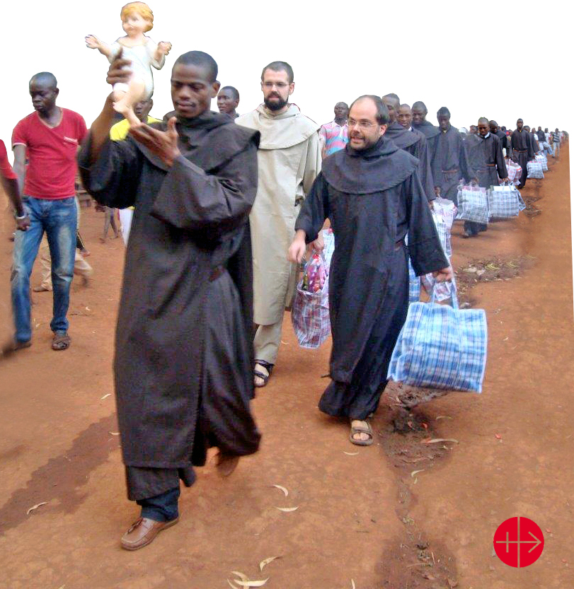 Central African Republic, Convent of the Carmelite Fathers at Bangui: Christmas 2014 Procession of Carmelite Fathers with statue of the Infant Jesus. Each Father is carrying bags with Christmas gifts for the refugee children. Fr. Fr. Mesmin Martinus Dingbedji (left with statue of Baby Jesus), Fr. Matteo Pesce (in the centre), Fr. Federico Trinchero: right. Used as Illustration for the Internet Project CENTRAL AFRICAN REPUBLIC / NATIONAL 15/00137 PrID: 1501487