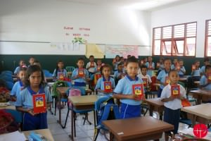 """Children with the Child´s Bible """"God speaks to his children"""" in Tetum language for East Timor  EAST TIMOR / NATIONAL 13/00038 Reprint of the Child's Bible """"God speaks to his children"""" in Tetum for the Salesian Schools in East Timor - 10,000 copies"""