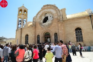 Syria 2015 May Badly damaged church St. Elijah in  Al-Qusayr (Qussair, Qusair, Alqseir). Pastoral visit of His Beatitude Patriarch Gregorios III Laham and the Ordinary of the Greek-Melkite Archdiocese of Homs, Hama and Yabroud Mgr Jean Abdou Arbach B.C. to the Parish of St. Elijah in  Al-Qusayr (Qussair, Qusair, Alqseir)