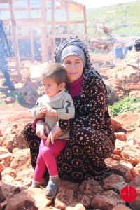 Mother with child - syrian Muslim refugees in a camp near Deir al Ahmar. Sr. Micheline helps them from day one on. LEBANON / BAALBEK-MAR 15/00052 PrID: 1502438 Aid to refugees in the region of Deir El Ahmar – 2015 LEBANON / BAALBEK-MAR 15/00050   PrID: 1500532 Support and development of the mission of the Sisters of Our Lady of Charity of the Good Shepherd, the Good Shepherd Social Centre, Deir Al Ahmar, Baalbeck, Bekaa