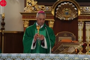 Ukraine, Odesa: Roman-Catholic Bishop Bronislaw Bernatsky elevating the Chalice during the Holy Mass at Odesa Cathedral.