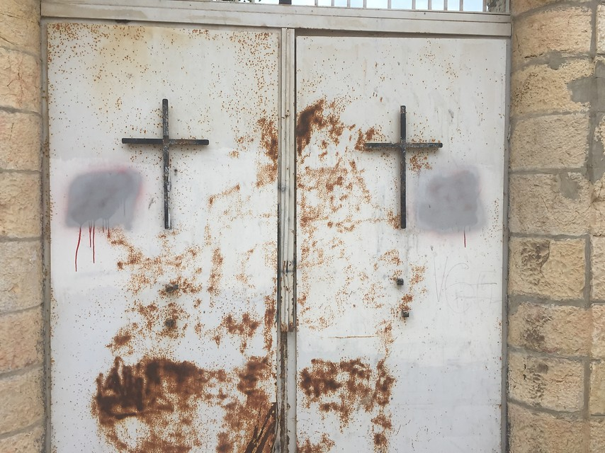"Photo Credit: Dormition Abbey Jerusalem Holy Land/Jerusalem, 19 Jan. 2016. The Abbey of the Dormition in Jerusalem has once again been targeted by vandals. On Saturday night, unknown persons defaced the walls and doors of the German-speaking Benedictine monastery on the outer edges of the Old City of Jerusalem. Also targeted were nearby establishments of the Greek Orthodox and Armenian Apostolic church. The graffiti, which had been written in Hebrew and in several different handwriting styles, proclaimed: ""Christians go to hell"", ""Death to heathen Christians, the heretical enemies of Israel"", ""Revenge for Israelis"" or ""Erased be His name"". A sword dripping with blood was also drawn next to a Star of David."