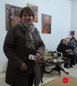 """ARMENIA / NATIONAL 15/00102 Programs for the improvement of livelihood of Syrian Armenian refugees in Armenia (vocational & psychological): On December 25th and December 28th, ART organized the distribution of plastic cards in close cooperation with Araratyan Patriarchal Diocese of the Armenian Apostolic Church and """"Aleppo"""" NGO, which Syrian refugees, particularly women, attend regularly for psychosocial sessions that contribute to their recovery and improve their resilience. Plastic payment cards give the free access to their choice of food products, and allow them a restricted purchase of alcohol and cigarettes. Bishop Navasard Kchoyan welcomed Syrian refugees with prayers and encouraged their involvement in Church activities. The Bishop underlined that Syrians have their own unique features, and today they enrich our lives, returning to their Armenian roots under the sad circumstances. He expressed gratitude to Syrian-Armenian spirit and the love, faith, and traditions. Here: Syrian refugee woman with the plastic card"""