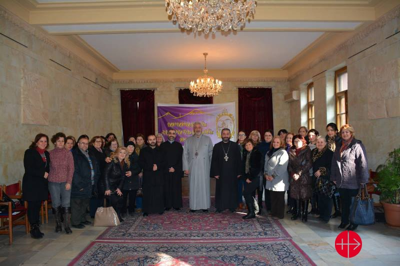"ARMENIA / NATIONAL 15/00102 Programs for the improvement of livelihood of Syrian Armenian refugees in Armenia (vocational & psychological): On December 25th and December 28th, ART organized the distribution of plastic cards in close cooperation with Araratyan Patriarchal Diocese of the Armenian Apostolic Church and ""Aleppo"" NGO, which Syrian refugees, particularly women, attend regularly for psychosocial sessions that contribute to their recovery and improve their resilience. Plastic payment cards give the free access to their choice of food products, and allow them a restricted purchase of alcohol and cigarettes. Bishop Navasard Kchoyan welcomed Syrian refugees with prayers and encouraged their involvement in Church activities. The Bishop underlined that Syrians have their own unique features, and today they enrich our lives, returning to their Armenian roots under the sad circumstances. He expressed gratitude to Syrian-Armenian spirit and the love, faith, and traditions. Here: Group picture of Syrian refugees with Bishop Navasard Kchoyan Only this very small file quality avaiable"