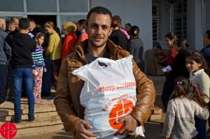 Iraq, January 2015Young man with one of the food packages distr