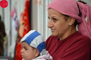 Iraq, January 2015Women with litte baby in small refugee PVC ca