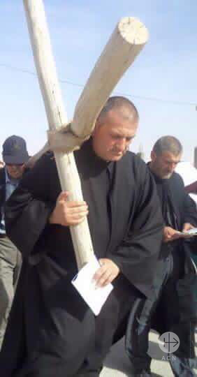 Picture of Father Mourad, kidnapped on 21st May 2015, carrying a cross. Only this low quality file available (picture sent to Fr Halemba during his trip to Syria)