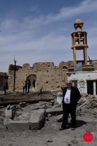 ACN Middle East specialist, Father Halemba in front of St Elian Church (Syriac Orthodox) in Ql-Qaryateyn